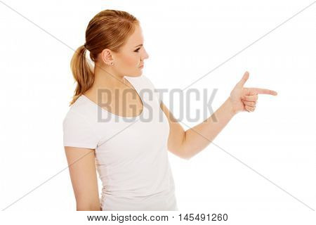 Young woman threatens someone the finger