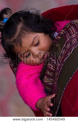 Portrait Of A Curious Native Peruvian Baby