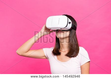 Young Woman looking though VR device