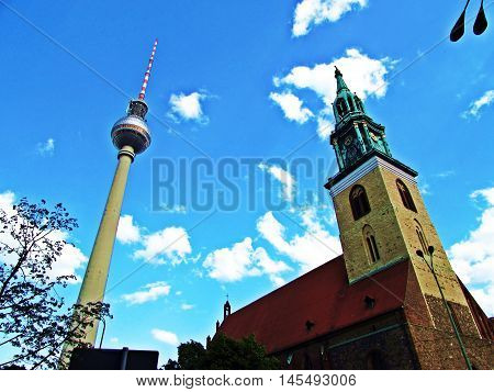 TV Tower Berlim in the Blue Sky and Church