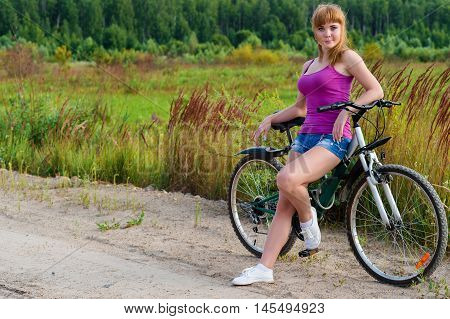 beautiful woman on bicycle on nature outdoors