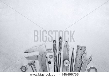 Vernier Caliper, Drills, Bolts, Pliers And Screws On Scratched Background