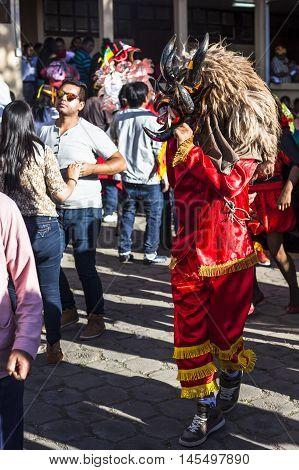 Píllaro ECUADOR - FEBRUARY 6 2016: Unidentified man dressed as Devil in the diabladas festivities in pillaro.
