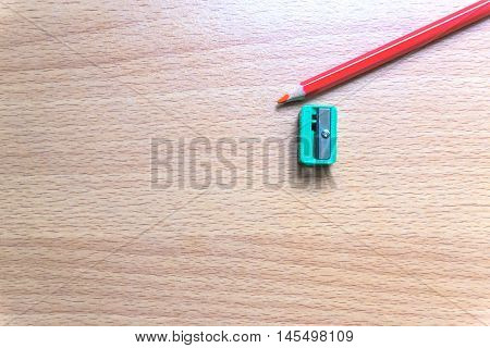 Pencil, sharpener, closeup wood desk , copy space / business concept / view from above, top view