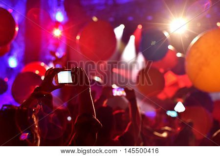 Silhouette Of People Taking Photos With Smart Phones At Live Concert