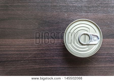 Stir Fried chicken with yellow curry paste(khaw-kling). Thai food in canned on wooden floor