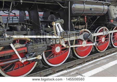 Ulan-ude, Russia - July, 16 2014: Wheels Of Old Vintage Steam Locomotive Ea Series On The Station In