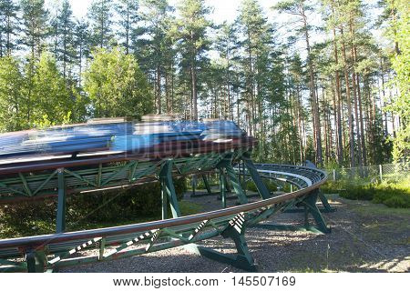 Kouvola, Finland 1 July 2015 - Ride Orient Express In Motion In Amusement Park Tykkimaki