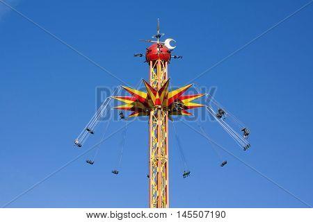 Kouvola, Finland 1 July 2015 - Ride Star Flyer In Motion In Amusement Park Tykkimaki