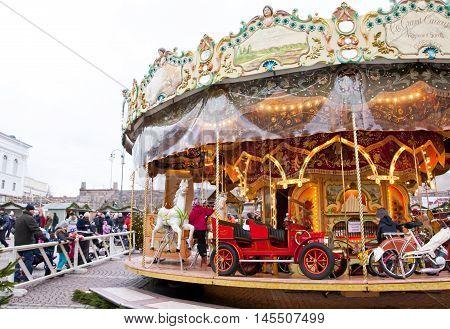 Helsinki Finland 21 December 2015 - Traditional Carousel at Christmas Market on Senat Square in motion