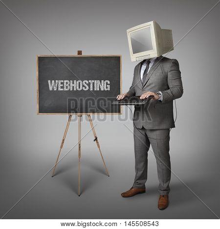 Webhosting text on blackboard and computer monitor on businessman head