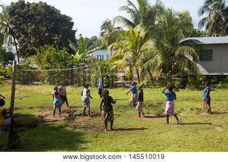 Chea Village, Solomon Islands - May 31, 2015: Women and girls playing volleyball in Chea village in Marovo Lagoon