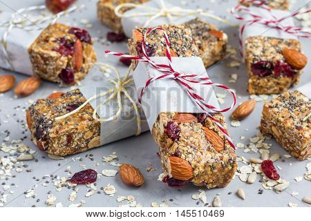 Homemade granola energy bars with figs oatmeal almond dry cranberry chia and sunflower seeds healthy snack