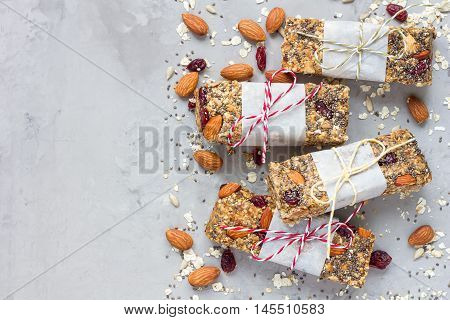 Homemade granola energy bars with figs oatmeal almond dry cranberry chia and sunflower seeds healthy snack top view copy space