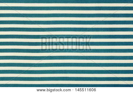 Fabric background in horizontal blue and white stripe, cotton texture, top view.
