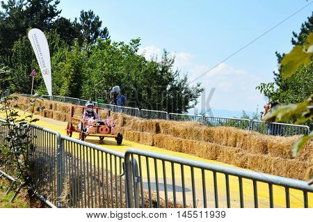 CLUJ-NAPOCA ROMANIA - SEPTEMBER 3 2016: Unidentified competitor races in a homemade piggy car at the Red Bull Soapbox Race