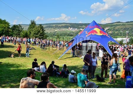 CLUJ-NAPOCA ROMANIA - SEPTEMBER 3 2016: People relaxing and socializing outdoors at the Red Bull Soapbox Race