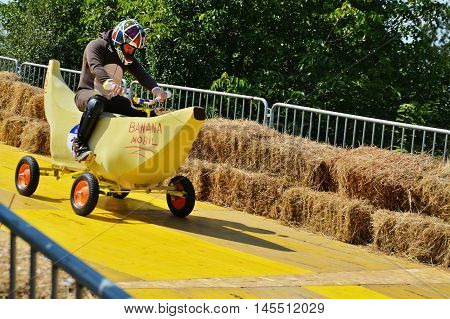 CLUJ-NAPOCA ROMANIA - SEPTEMBER 3 2016: Unidentified racer drives a banana mobil down the racetrack at the Red Bull Soapbox Race