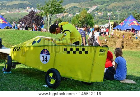 CLUJ-NAPOCA ROMANIA - SEPTEMBER 3 2016: Unidentified racer fixes his race mobil at the Red Bull Soapbox Race