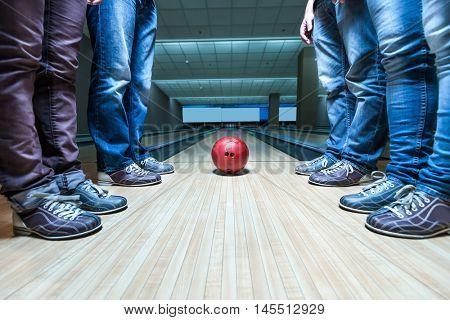People near bowling ball