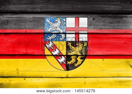 Flag Of Saarland, Germany, Painted On Old Wood Plank Background