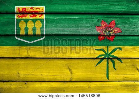Flag Of Saskatchewan Province, Canada, Painted On Old Wood Plank Background