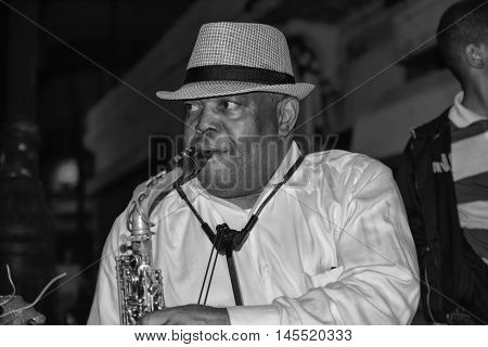 SANTO DOMINGO, DOMINICAN REPUBLIC - January 24, 2016: Street artist with saxophone in Calle el Conde, Santo Domingo, Dominican Republic.