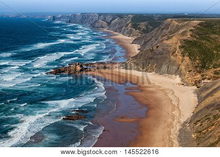 View over west Algarve coast beach popular with surfers Portugal