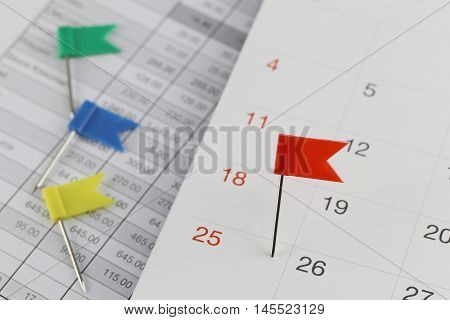 Red Pins to Wildcats on the calendar beside the number of twenty five in business concept time and date.