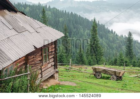 Old wooden house in mountain. cheese dairy. Carpathians Ukraine