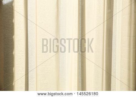 Sunlight falling through a semi transparent curtain.