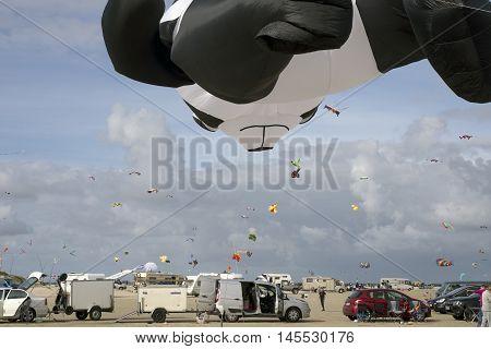 LAKOLK DENMARK - SEPTEMBER 3 2016: Colorful kites on the big beach on Lakolk Romo. International Kite Festival for the 27th time. September 3 2016.