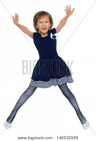 Cheerful Caucasian little girl in a short blue dress jumping . Girl photographed at the time of the jump - Isolated on white background