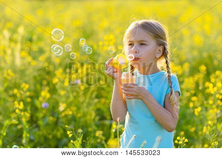Keep calm and blow bubbles. Cropped shot of cute young girl blowing bubbles outside, having fun