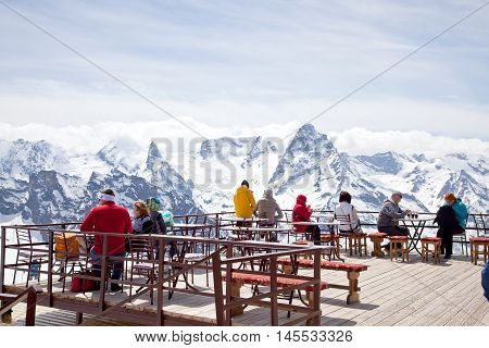 DOMBAY RUSSIA - May 03.2015: Interior of verandah of alpine cafe on mountain Mussa-Achitara. People admire mountains