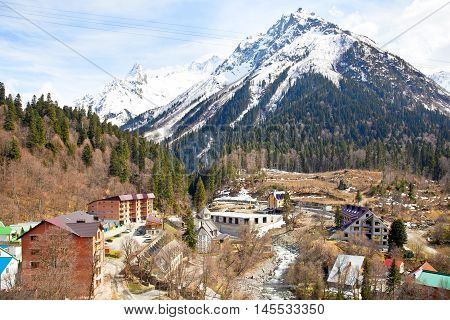 DOMBAY RUSSIA - May 03.2015: Dombai Glade. The settlement in the Caucasus Mountains skiing resort