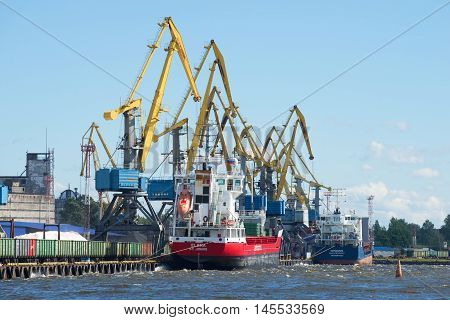 VYBORG, RUSSIA - AUGUST 08, 2016: Sunny august day in Vyborg cargo port. The main landmark of the city Vyborg