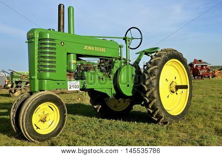 ROLLAG, MINNESOTA, Sept 1, 2016: An old restored John Deere A tractor is displayed at the West Central Steam Threshers Reunion(WCSTR) where 1000s attend each Labor Day weekend in Rollag, MN each year.