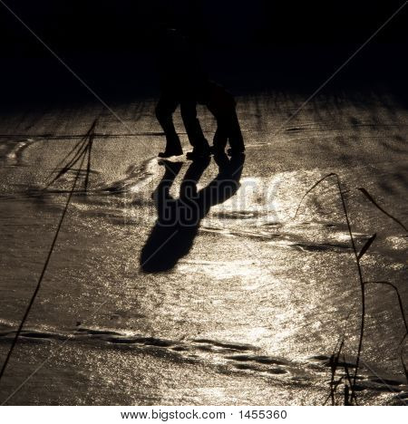 Illusion Of Centaur - Silhouettes Of Two People On Ice Against Sun