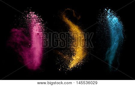 Explosions of colored powder, isolated on black background