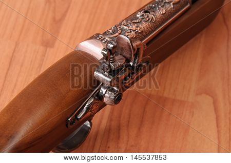 Vintage pistols on wooden background. Collectible antique weapons
