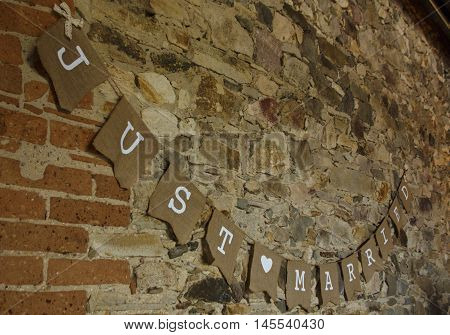 Just Married sign on a wall as decoration of a wedding party