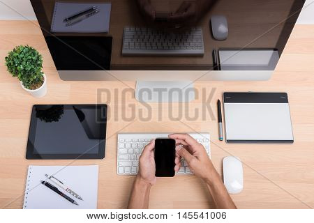 Top View Office Hand Working On Mobile Phone