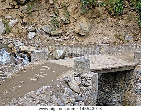 Wooden bridge in the mountains in Nepal, Annapurna trekking