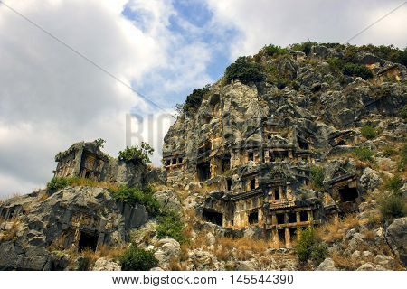 Historical tombs in the mountains near Myra town , Turkey