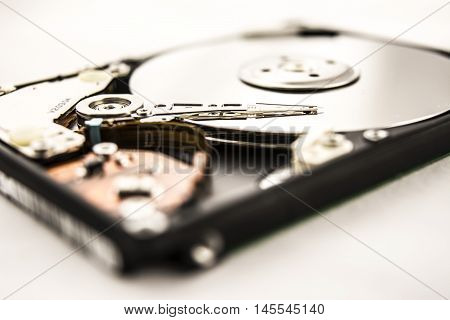 Laptop HDD on the white background. Disassembled hard disk (without top cover). inside view of notebook hard disk.