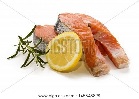 scottish salmon steak with slice lemon and rosemary on white background