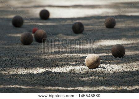 Petanque ball boules bawls on a dust floor