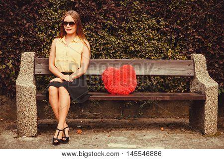 Smiling Girl Sitting On Bench.