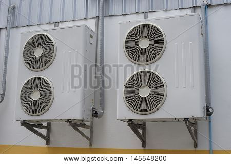 Group Of Air Conditioner Units On Wall Outside Building.